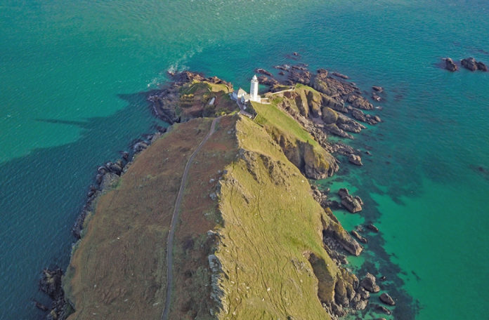 The Start Point lighthouse is located in the South Hams district on the Devon coast, a county in southwestern England