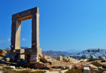 The Portara of Naxos or Naxos Temple Gate called fragment of the Temple of Apollo on Naxos, an island of the Cyclades, is considered the landmark of Naxos. The gate is located on a peninsula in front of the city of Naxos.