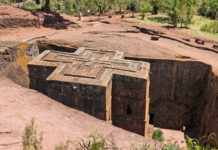 Lalibela - New Jerusalem To view all 11 temples, you need to climb up the mountainside or climb to the top on a mule. The brick red tufa from which the churches are carved harmonizes with the greenery of the surrounding hills and the blue sky.