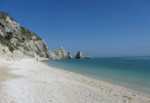 Two twin rocks overlooking the clear waters that caress the Conero Riviera.