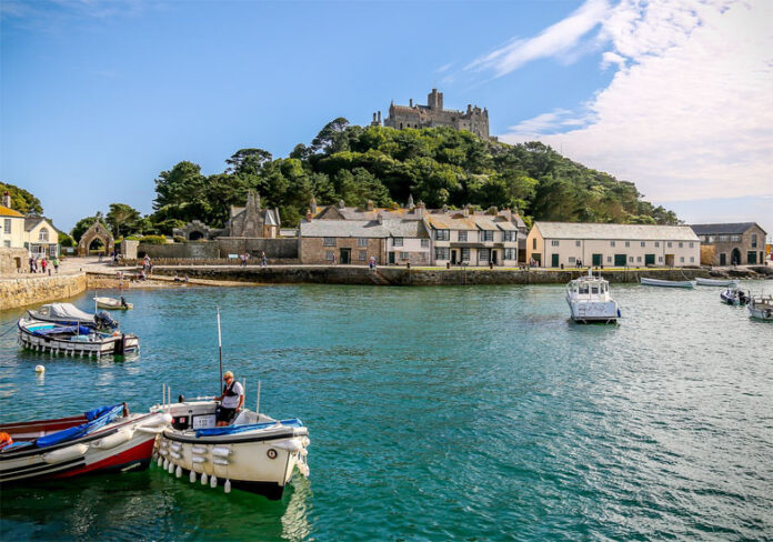 St Michael's Mount is an accessible island at low tide in the shape of a pyramid of granite which rises to 60 m, located in Mount's Bay in Cornwall